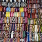 Some of the vibrant colours and designs. Made by hand using natural ingredients. Chincheros Cusco Peru.